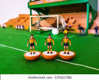 Wolves Subbuteo football figures lined up on a grass field