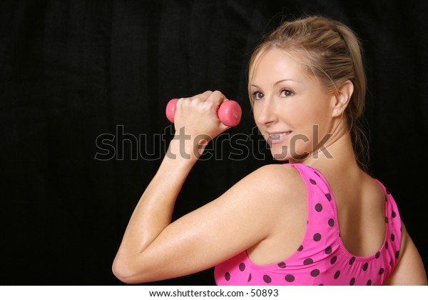 Woman with 0.5kg hand weights.