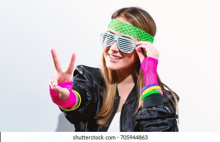 Woman in 1980's fashion on a white background
