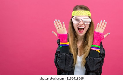 Woman in 1980's fashion theme on a pink background