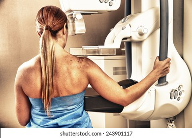 Woman in 40s about to undergoing a mammography test.