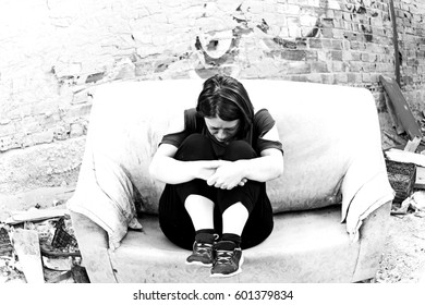 Woman in abandoned house alone and sad, problems