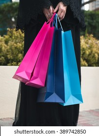 Woman in Abaya Is Holding Shopping Bags Close Up