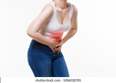 Woman with abdominal pain, stomachache on white background, studio shot