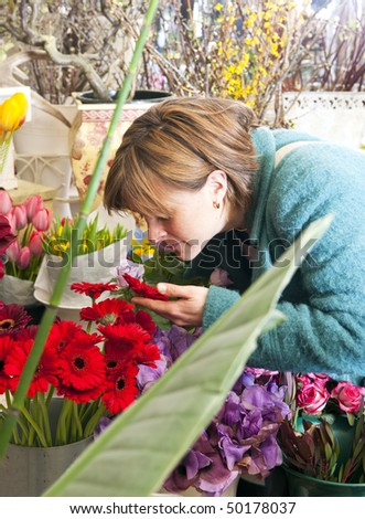woman absorbing scent flower whilst shopping stock photo edit now