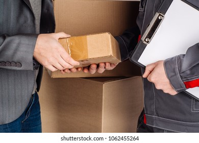 woman accepting a delivery of boxes from delivery service courier