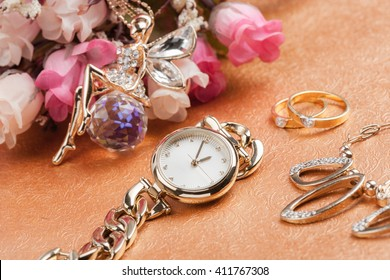 woman accessories, closeup shiny gold women wristwatch