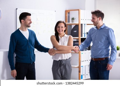 Woman Acting As Middleman In Deal Shaking Hands