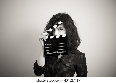 Woman actress eyes portrait behind movie clapper board vintage black and white
