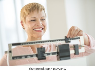 Woman adjusting sliding weight scale