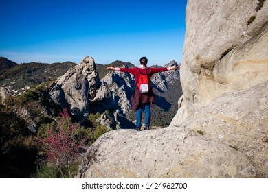 Woman admires the landscape of Dolomites of Basilicata mountains called Dolomiti Lucane. Basilicata region, Italy