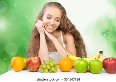 Woman admiring her fruit.