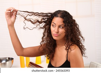 Woman admiring her long hair