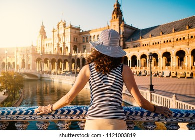 Woman admiring Plaza de Espana (Spain Square). Built on 1928, it is one example of the Regionalism Architecture mixing Renaissance and Moorish styles. Seville, Spain. Life style.