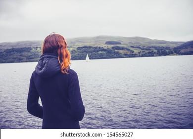 Woman admiring stillness of the lake