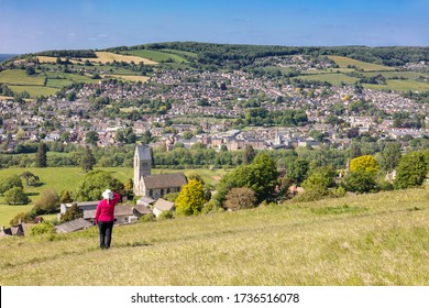 Woman admiring view across to Stroud from Selsley Common, The Cotswolds, Gloucestershire,England, United Kingdom