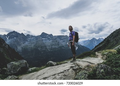 Woman admiring the view while hiking the Austrian Alps