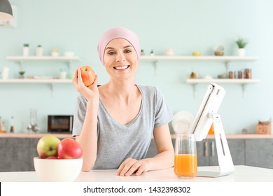 Woman after chemotherapy in kitchen at home