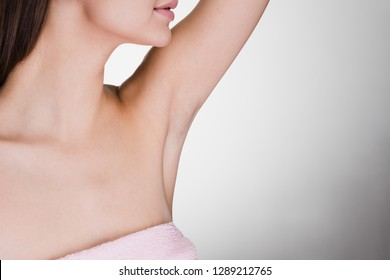 woman after shower on a gray background