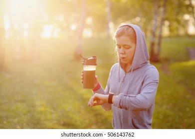 Woman after workout. Detox smoothie. Marathon runner