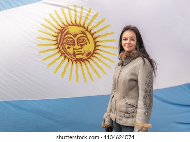 woman against the background of the Argentine flag