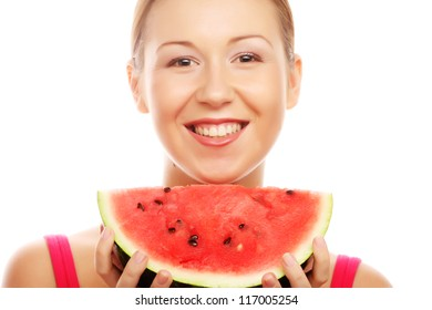 Woman against white background holding watermelon ready to take a bite