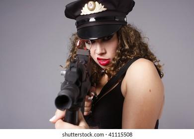 Woman aiming an assault rifle.