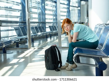 woman at the airport. waiting hall. flight delay