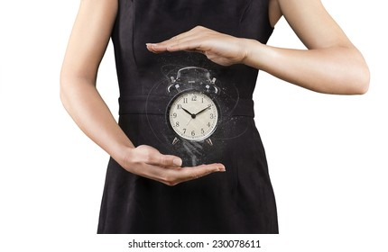 Woman with alarm clock between hands, isolated on white, magic, time is running