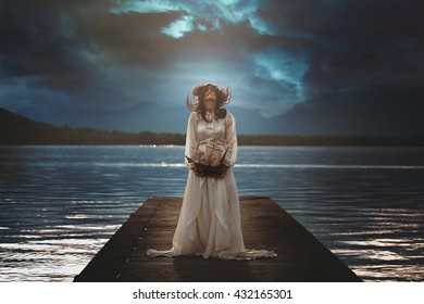 Woman alone on surreal lake pier . Dramatic cloudscape