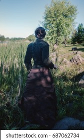 A woman in ancient clothes runs along the swamp