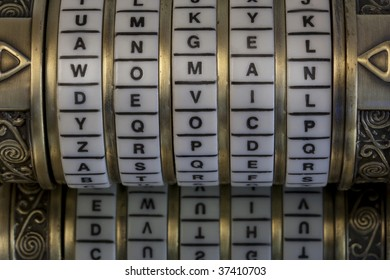 woman, angel, devil - keywords or passwords  set on combination puzzle box (cryptex) with letter rings, mirror reflection