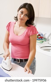 Woman Annoyed To Be Ironing