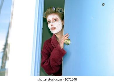 Woman answering door unprepared