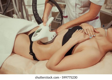 Woman anti-cellulite treatment at medical spa center
