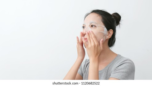 Woman apply paper mask skin care