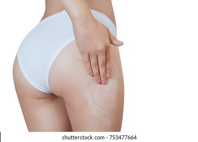 A woman is applying an anti-cellulite cream The concept of sport and a healthy lifestyle.