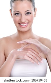 Woman applying cosmetic cream on hands