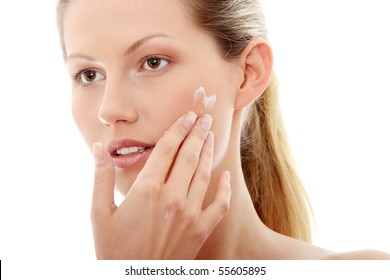 Woman applying cream, isolated on white