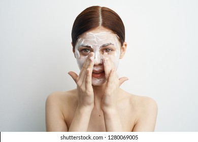 woman applying cream on face care