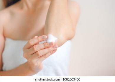 Woman applying elbow cream, Hygiene skin body care concept.