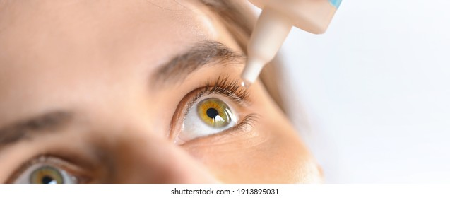 Woman applying eye drop. Vitamin drops from tiredness and redness eyes. Suffering from irritated eye,optical symptoms.