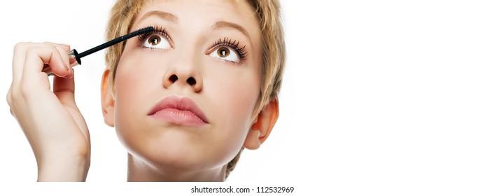 Woman applying eye make-up with brush