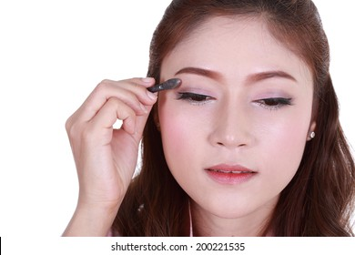 woman applying eyeshadow powder isolated on white background