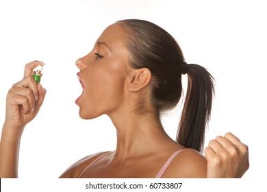 woman applying Fresh breath spray