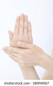 woman applying hand cream on her hand,