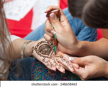 Woman applying henna