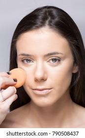 woman applying make up .beauty shoot
