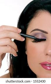 Woman applying makeup - closeup