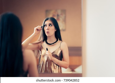 Woman Applying Mascara Getting Ready for Party - Beautiful girl in front of a mirror preparing for a night out